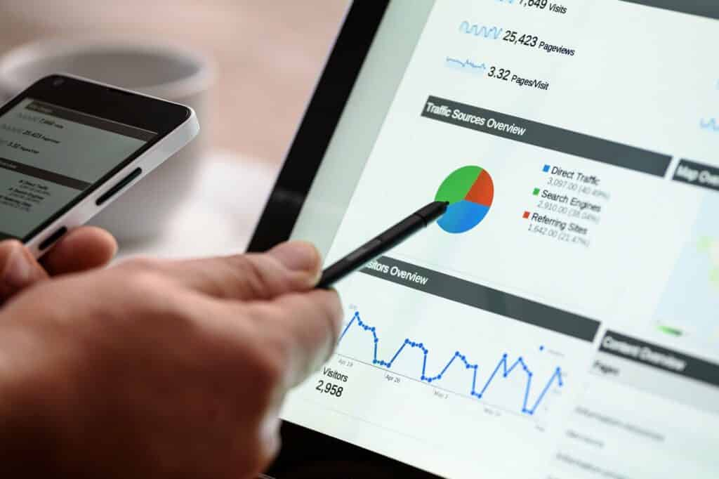 pen pointing to marketing charts